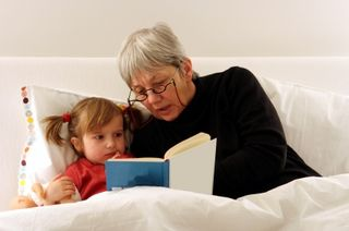 Grandmother reading story bedtime